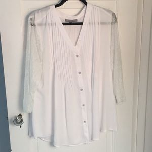 White blouse with silver buttons and lace sleeves